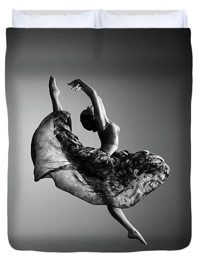 Ballerina Duvet Cover featuring the photograph Ballerina jumping by Johan Swanepoel