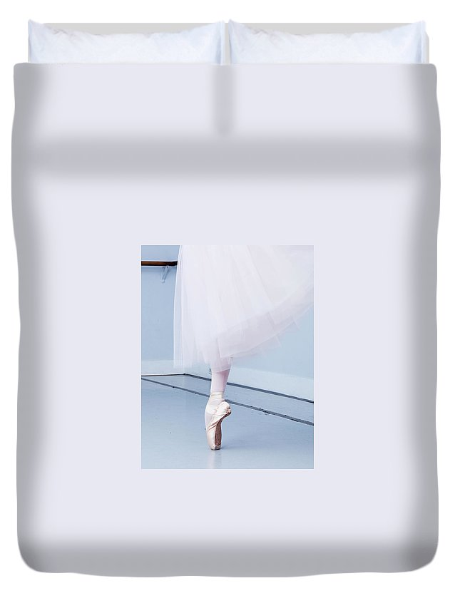 Expertise Duvet Cover featuring the photograph Ballerina On Pointe Low Angle View by Jonya