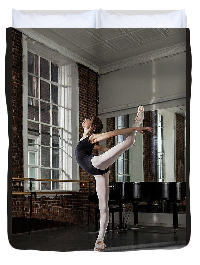 Ballet Dancer Duvet Cover featuring the photograph Ballerina Performing Attitude In Dance by Nisian Hughes