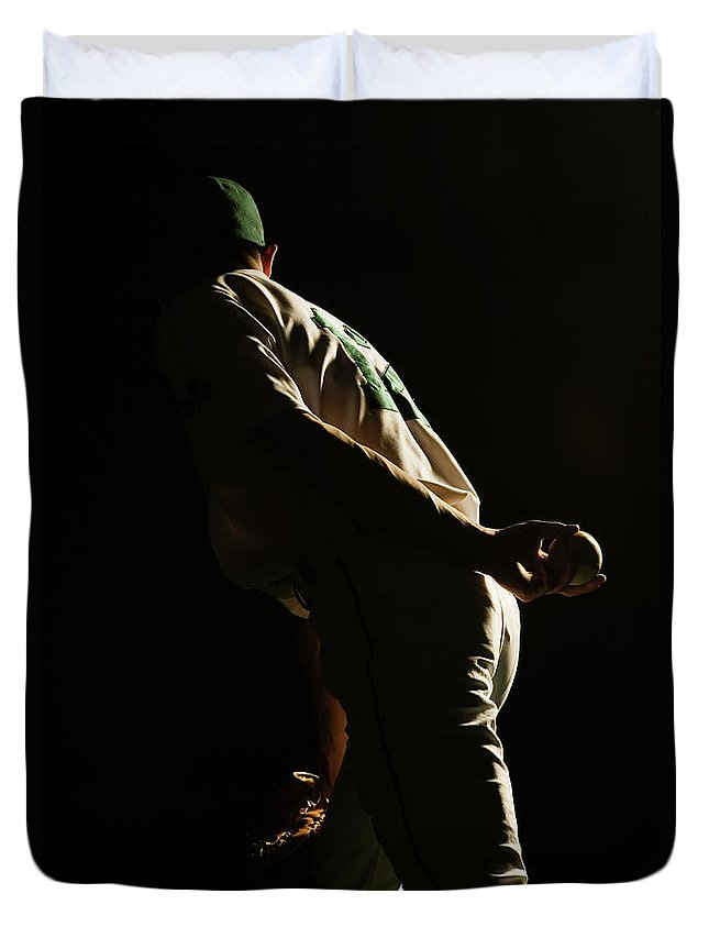Three Quarter Length Duvet Cover featuring the photograph Baseball Pitcher Holding Ball Behind by Pm Images