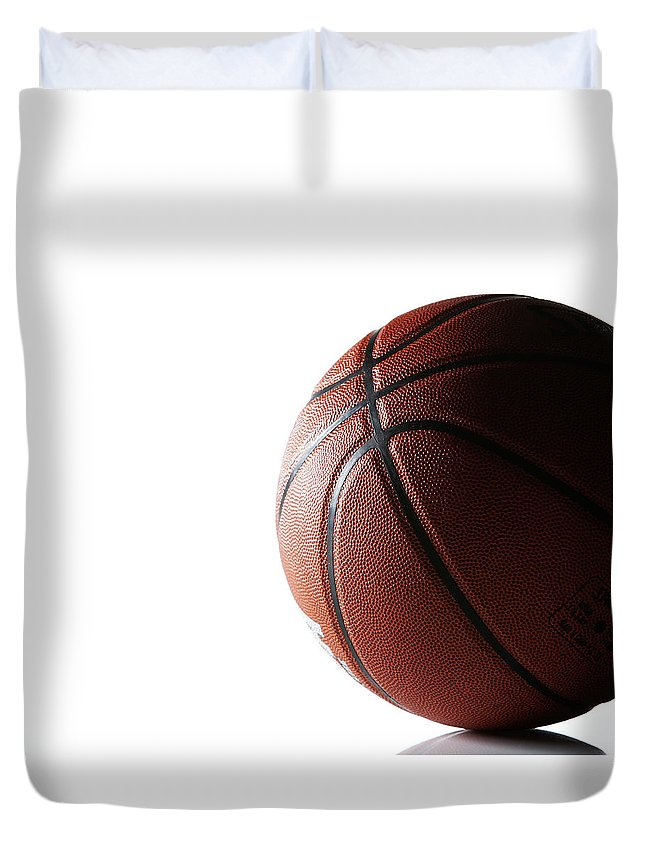 Recreational Pursuit Duvet Cover featuring the photograph Basketball On White Background by Thomas Northcut