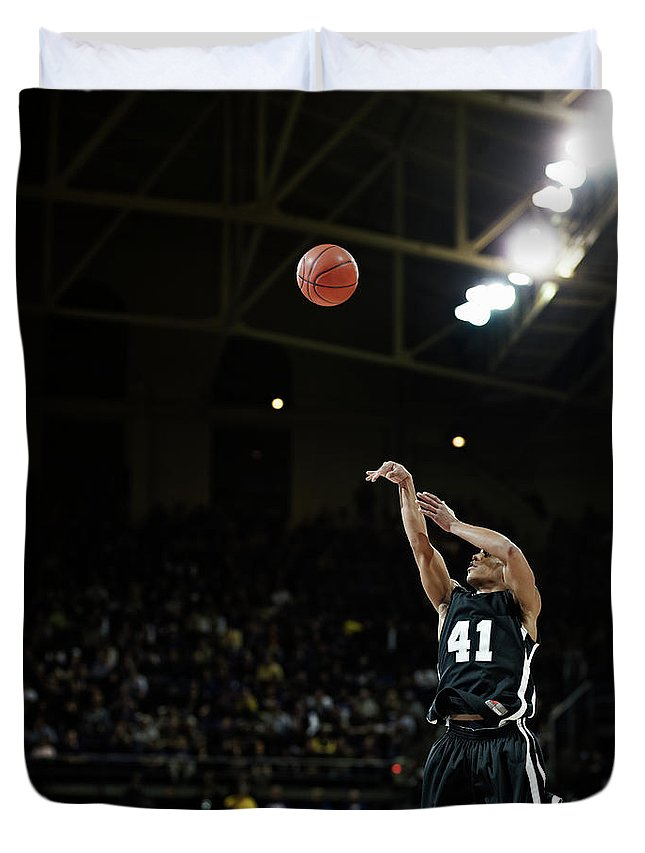 Expertise Duvet Cover featuring the photograph Basketball Player Shooting Jump Shot In by Thomas Barwick