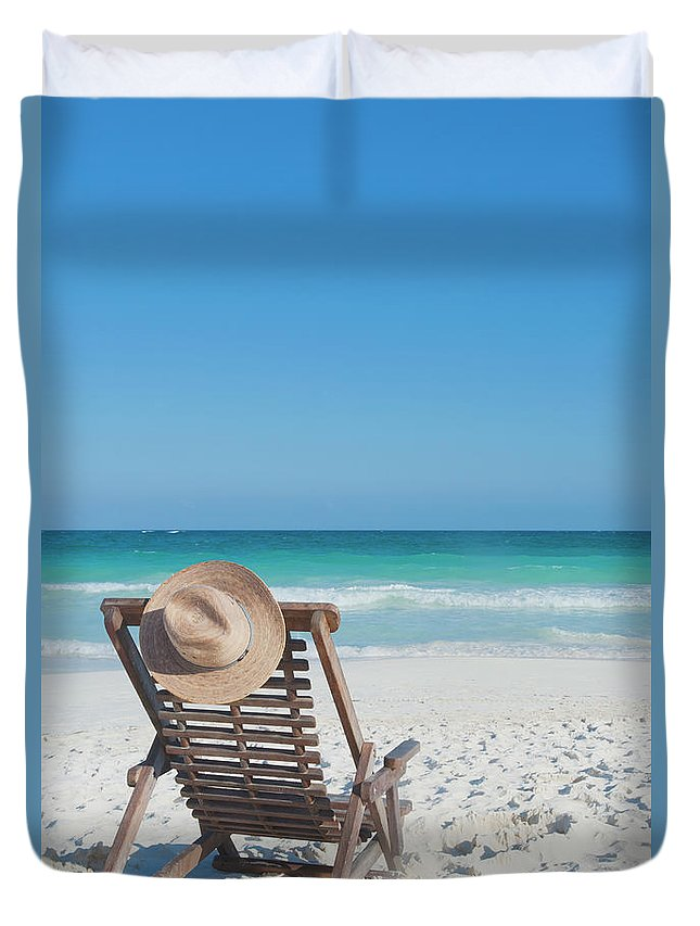 Scenics Duvet Cover featuring the photograph Beach Chair With A Hat On An Empty Beach by Sasha Weleber