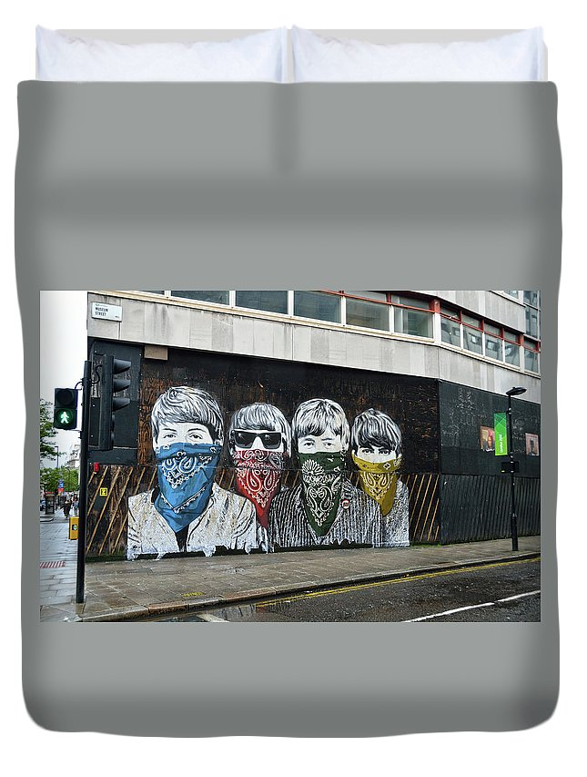 Bansky Duvet Cover featuring the photograph Yhe Beatles wearing face masks street mural in London by RicardMN Photography