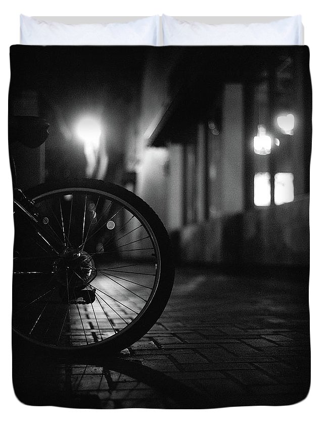 Shadow Duvet Cover featuring the photograph Bicycle In Dark Street by Satoshi Otani