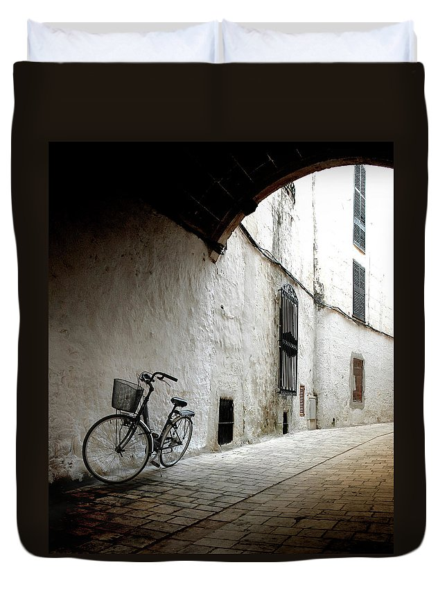 Tranquility Duvet Cover featuring the photograph Bicycle Leaning Wall by Antonio R. Ramos