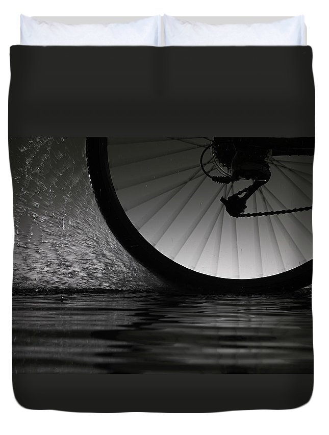 Recreational Pursuit Duvet Cover featuring the photograph Bike Riding Through Water by Jonathan Knowles