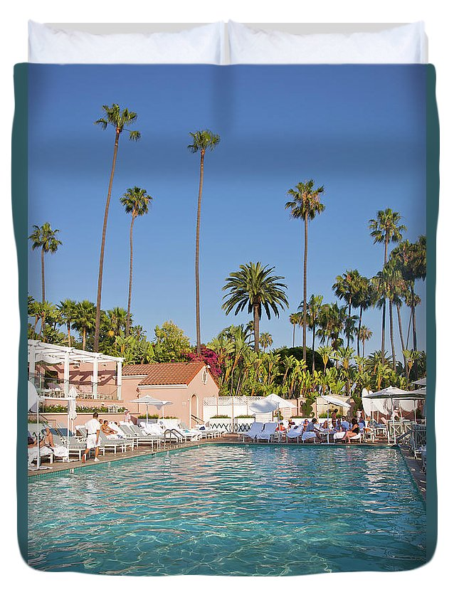 Tranquility Duvet Cover featuring the photograph Blue-bottomed Pool Beneath Palm Trees by Barry Winiker