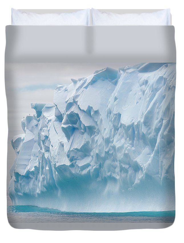 Scenics Duvet Cover featuring the photograph Blue Iceberg Carved By Waves Floats In by Eastcott Momatiuk