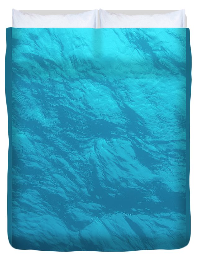 Tranquility Duvet Cover featuring the photograph Blue Ocean Water Surface As Seen From by Jeff Hunter