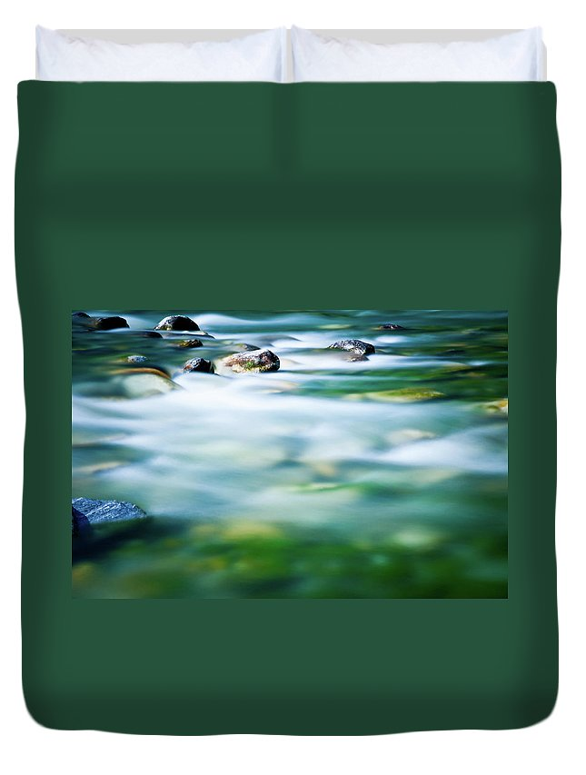 Scenics Duvet Cover featuring the photograph Blurred River by Assalve