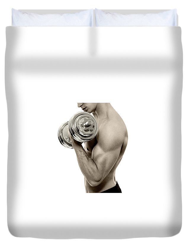 Young Men Duvet Cover featuring the photograph Body Builder Exercising by Gilaxia