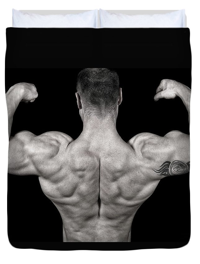 Toughness Duvet Cover featuring the photograph Bodybuilder Posing by Vuk8691