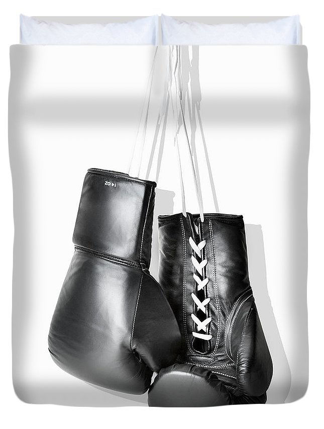 Hanging Duvet Cover featuring the photograph Boxing Gloves Hanging Against White by Burazin