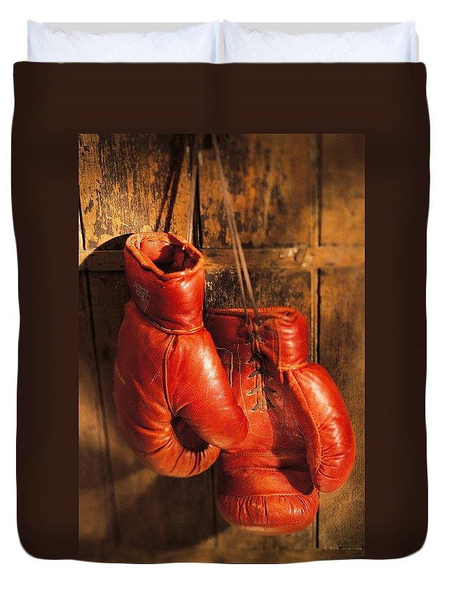 Hanging Duvet Cover featuring the photograph Boxing Gloves Hanging On Rustic Wooden by Comstock