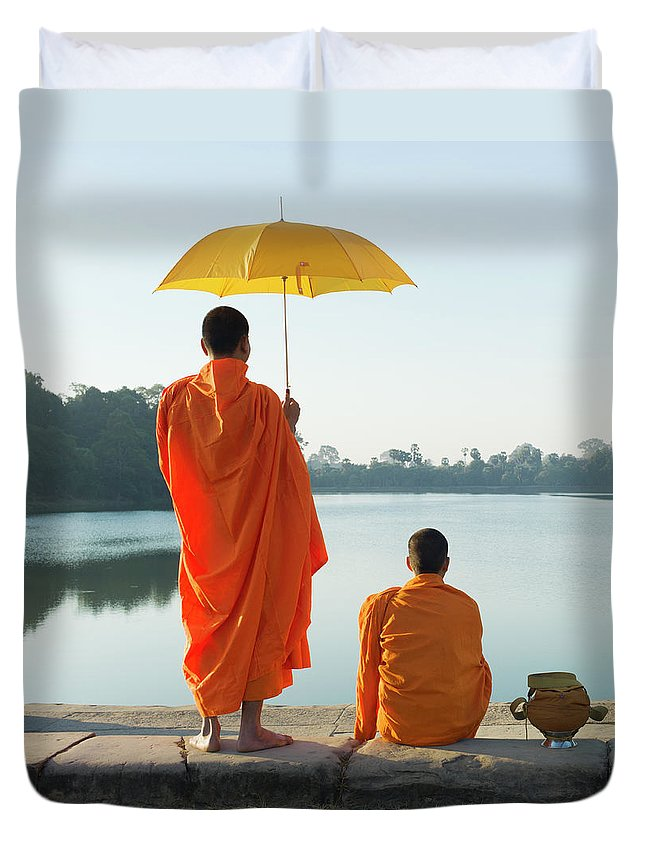 Young Men Duvet Cover featuring the photograph Buddhist Monks Standing In Front Of by Martin Puddy
