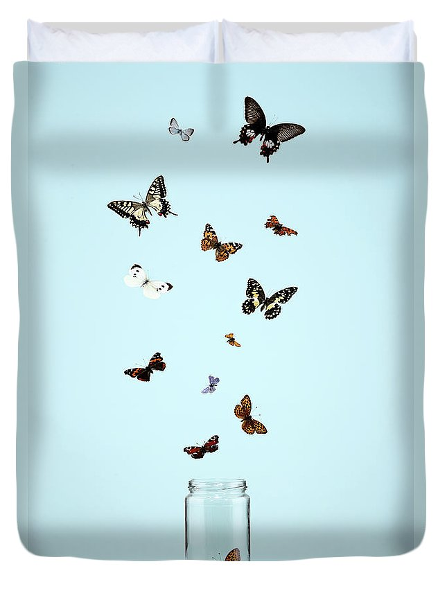 Animal Themes Duvet Cover featuring the photograph Butterflies Escaping From Jar by Martin Poole