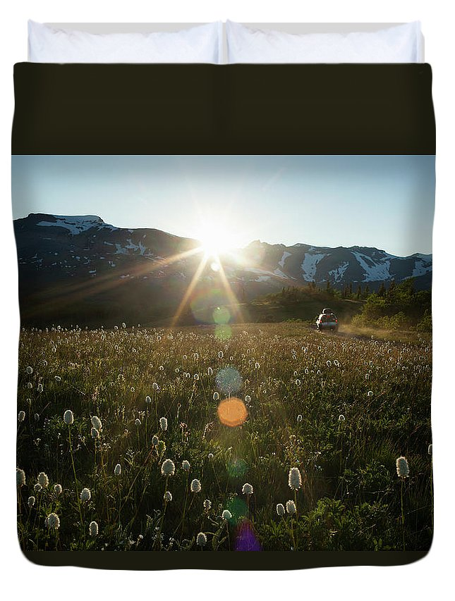 Scenics Duvet Cover featuring the photograph Car On Rural Dirt Road In Mountains At by Noah Clayton