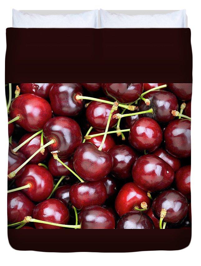 Cherry Duvet Cover featuring the photograph Cherries by Maria Toutoudaki