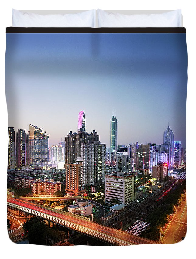 Corporate Business Duvet Cover featuring the photograph China, Shenzen Skyline At Dusk by Martin Puddy