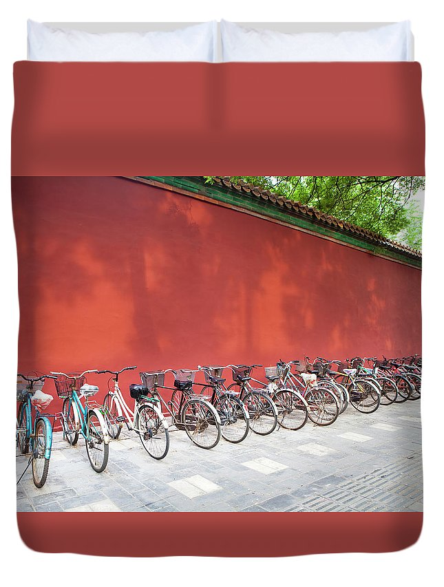 Shadow Duvet Cover featuring the photograph Chinese Bikes by Sam Diephuis