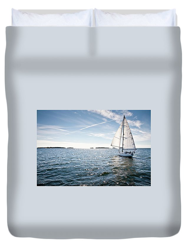 Recreational Pursuit Duvet Cover featuring the photograph Classic Yacht Sailing Away Against Blue by Jaap-willem