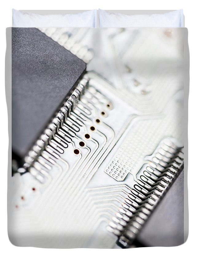 Electrical Component Duvet Cover featuring the photograph Close-up Of A Circuit Board by Nicholas Rigg