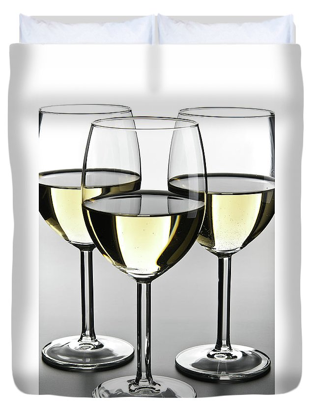 Alcohol Duvet Cover featuring the photograph Close-up Of Three White Wine Glasses by Domin domin
