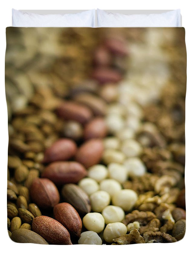 Nut Duvet Cover featuring the photograph Close Up Of Variety Of Nuts by Johner Images