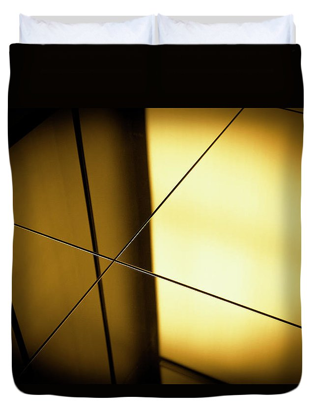 Shadow Duvet Cover featuring the photograph Close-up Spot Lit Reflection In Yellow by Ralf Hiemisch