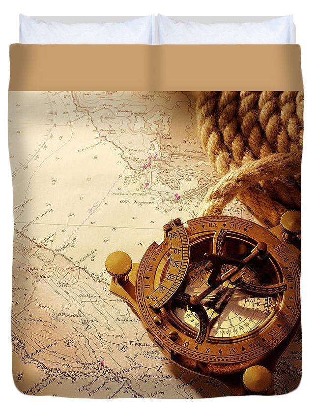 Rope Duvet Cover featuring the photograph Coiled Rope And Nautical Chart With A by Wragg