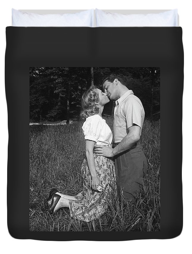 Heterosexual Couple Duvet Cover featuring the photograph Couple Kissing Outdoors by George Marks