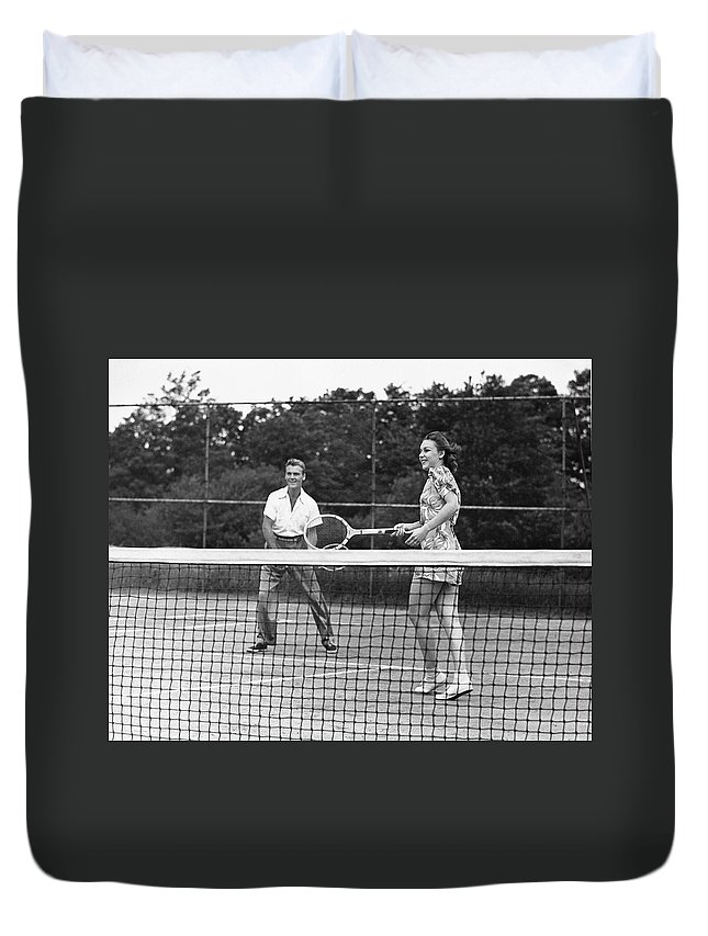 Heterosexual Couple Duvet Cover featuring the photograph Couple Playing Tennis by George Marks