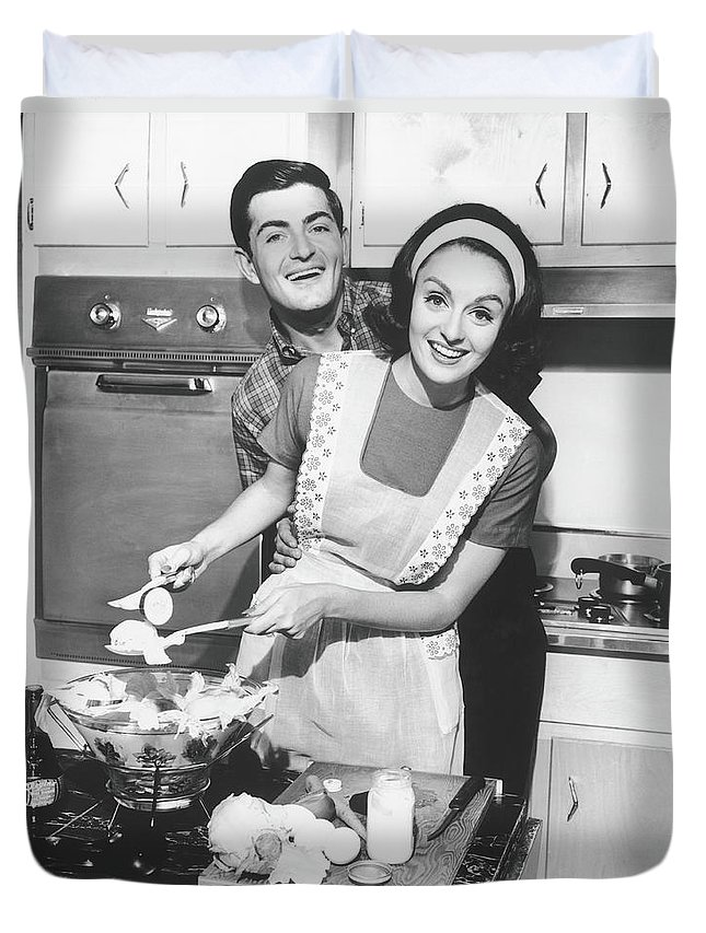 Heterosexual Couple Duvet Cover featuring the photograph Couple Standing In Kitchen, Smiling, B&w by George Marks
