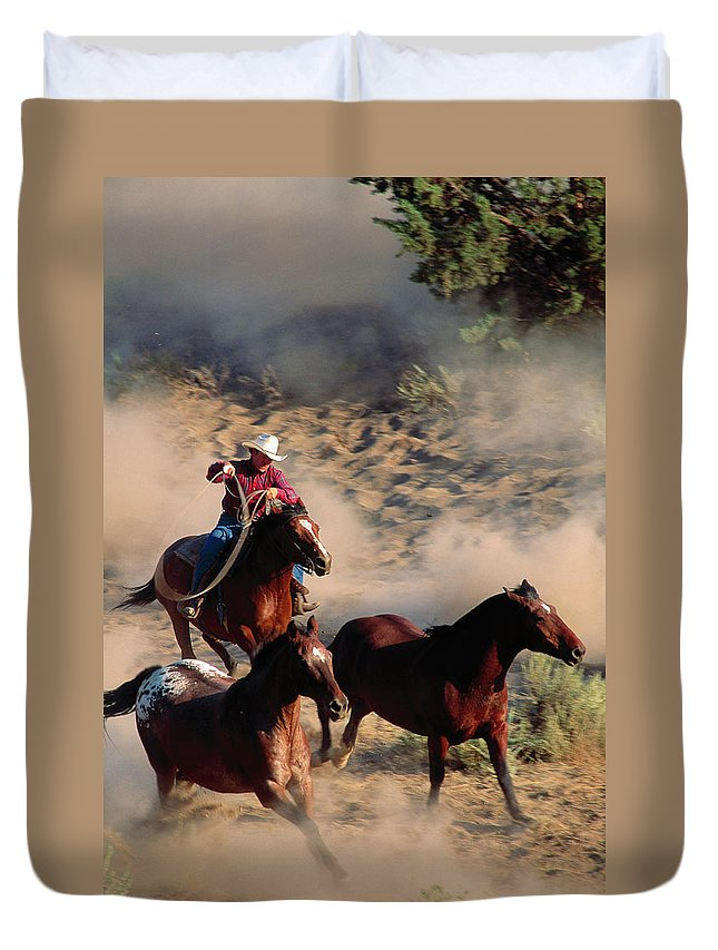 Horse Duvet Cover featuring the photograph Cowboy Roping Horses by John Luke