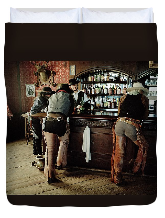 Young Men Duvet Cover featuring the photograph Cowboys At Saloon by Matthias Clamer