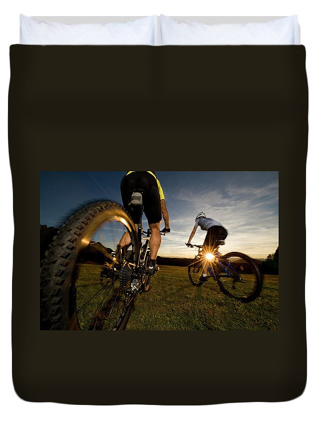 Blurred Motion Duvet Cover featuring the photograph Cycling Adventure by Gorfer