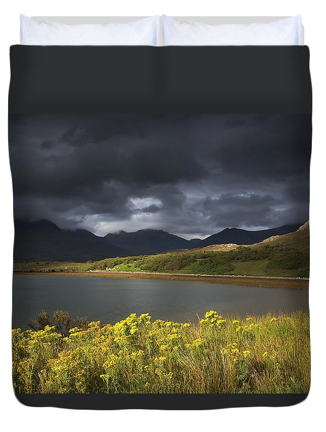 Tranquility Duvet Cover featuring the photograph Dark Storm Clouds Hang Over The by John Short / Design Pics