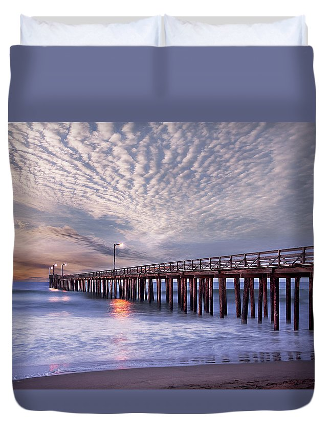 Scenics Duvet Cover featuring the photograph Dawn Clouds Over Pier In Pacific Ocean by Alice Cahill