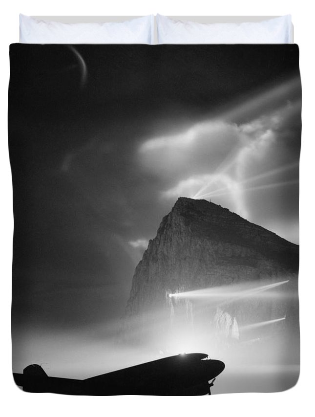 Rock Of Gibraltar Duvet Cover featuring the photograph Airliner Silhouetted By Searchlights - Rock Of Gibraltar - Ww2 by War Is Hell Store