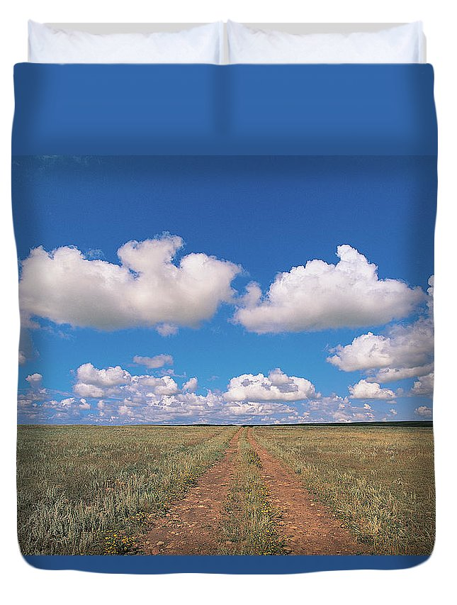 Grainy Duvet Cover featuring the photograph Dirt Road On Prairie With Cumulus Sky by Mimotito