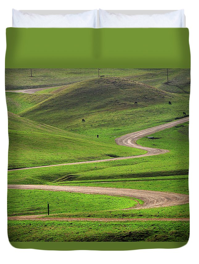 Tranquility Duvet Cover featuring the photograph Dirt Road Through Green Hills by Mitch Diamond