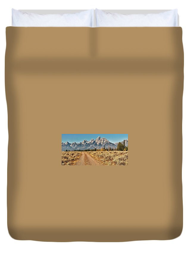Tranquility Duvet Cover featuring the photograph Dirt Road To Tetons by Jeff R Clow