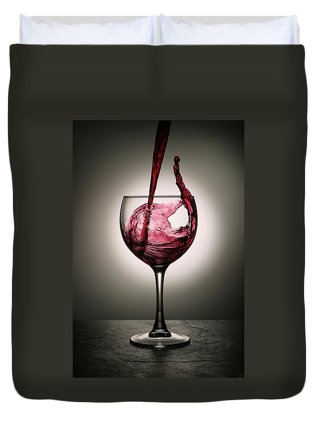 Alcohol Duvet Cover featuring the photograph Dramatic Red Wine Splash Into Wine Glass by Donald gruener