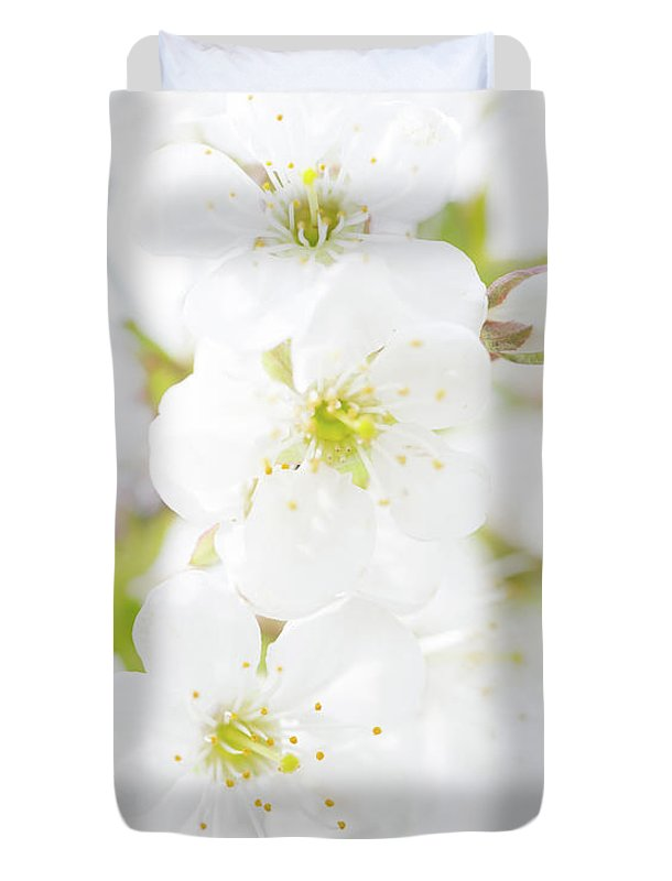 White Duvet Cover featuring the photograph Ethereal Blossoms by Emily Johnson