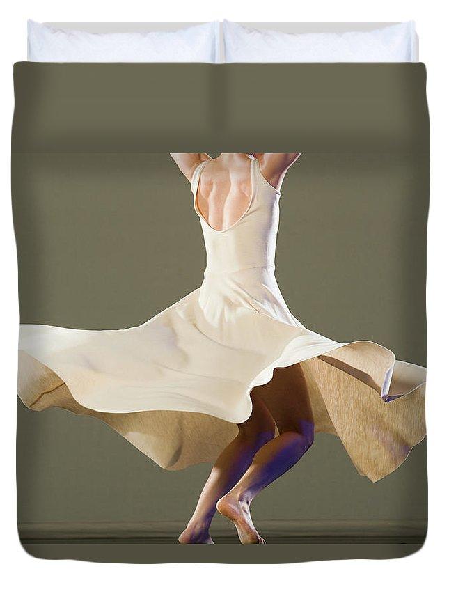 Ballet Dancer Duvet Cover featuring the photograph Female Ballet Dancer Dancing by Erik Isakson