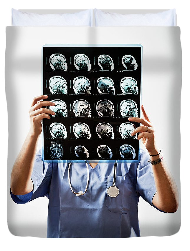Expertise Duvet Cover featuring the photograph Female Doctor Holds Up Mri In Front Of by Ron Levine
