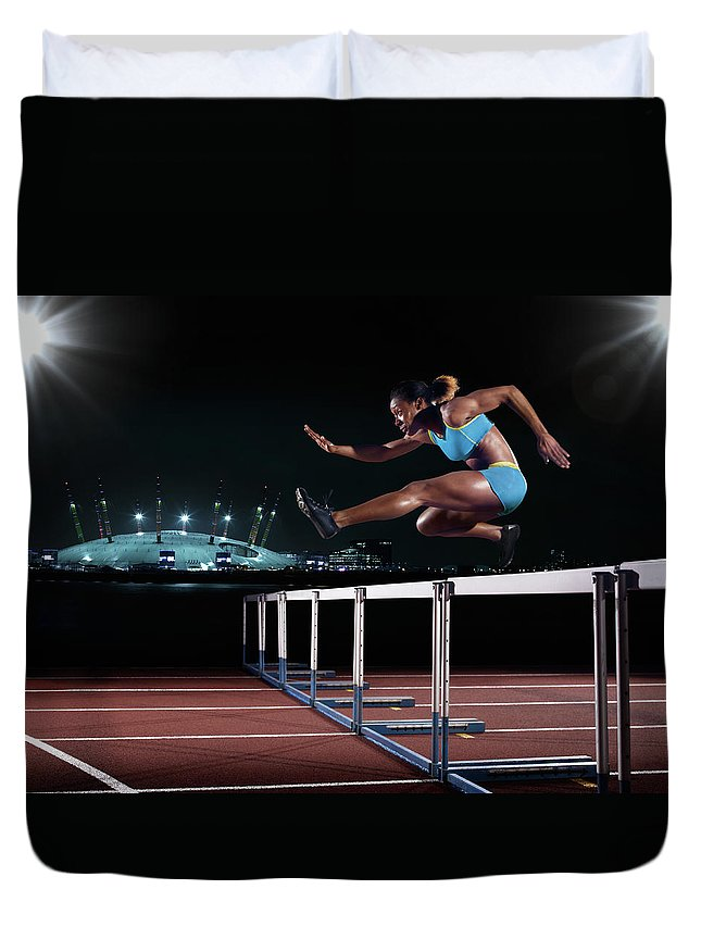 People Duvet Cover featuring the photograph Female Hurdling In London by Mike Harrington