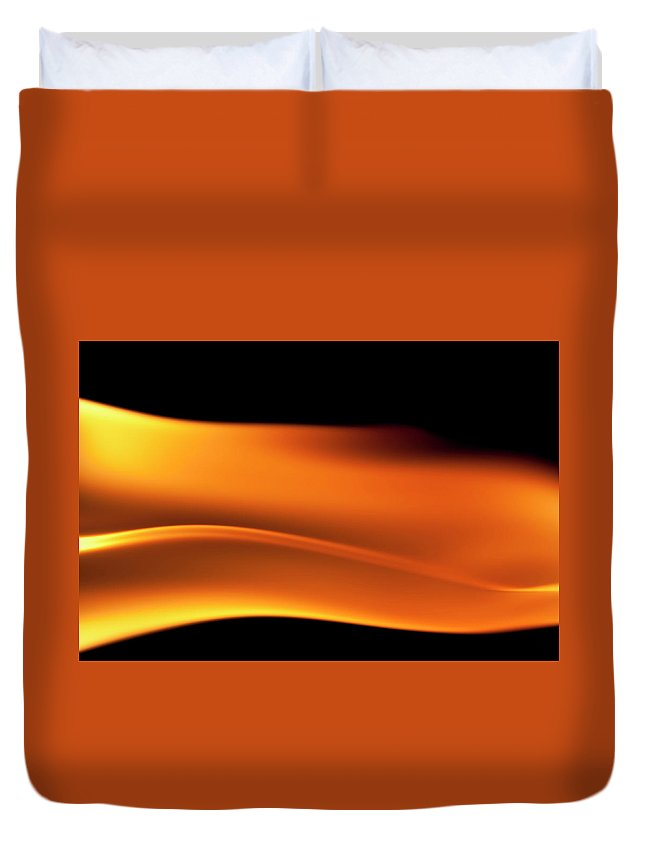 Orange Color Duvet Cover featuring the photograph Fire Burning, Flames On Black Background by Tttuna