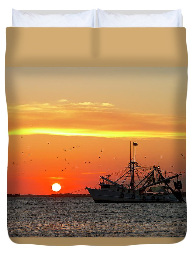 Water's Edge Duvet Cover featuring the photograph Fishing Boat At Sunset by Tshortell